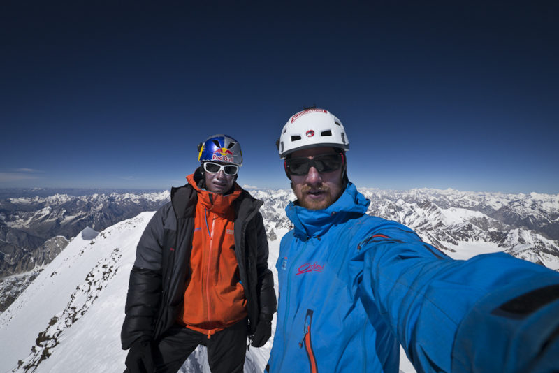 David and Peter on the ridge that connects the two peaks of roof shaped Chogolisa. ©Peter Ortner